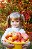 Little girl with fresh vegetables in garden Royalty Free Stock Image