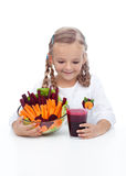 Little girl with fresh vegetables and juice Royalty Free Stock Images
