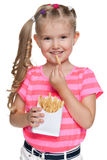 Little girl with fries Royalty Free Stock Image