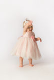 Little Girl in Frilly Dress Waving Royalty Free Stock Photography
