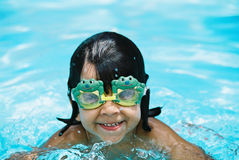 Little girl with frog goggles stock photo