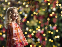 Little girl in front of a chrismas tree Royalty Free Stock Photo