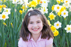 Little Girl in Front of Daffodils Royalty Free Stock Images