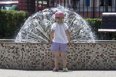 Little girl in front of fountain Royalty Free Stock Images