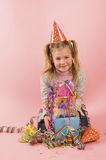 Little girl in front of her present on her birtday Royalty Free Stock Images