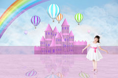 Little girl in front of a pink fairy castle Stock Photo