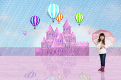 Little girl in front of a pink fairy castle Royalty Free Stock Photography