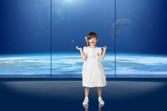Little girl in front of the window Royalty Free Stock Images
