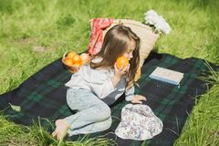 Little girl with fruit stock image