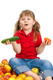 Little girl with fruit and vegetables Royalty Free Stock Photos