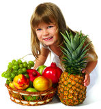 Little girl with fruits Stock Photo