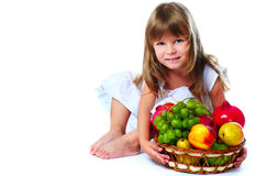 Little girl with fruits stock images