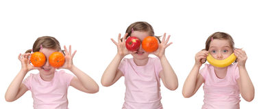 Little girl with fruits Stock Photography