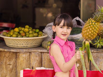 Little girl at fruits Royalty Free Stock Photo