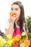Little girl with fruits Royalty Free Stock Images