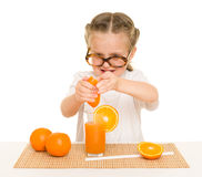 Little girl with fruits and vegetables make juice Stock Images