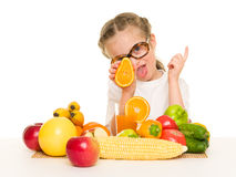 Little girl with fruits and vegetables make juice Stock Photos