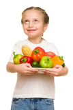 Little girl with fruits and vegetables on white Royalty Free Stock Image