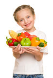 Little girl with fruits and vegetables on white Royalty Free Stock Photo