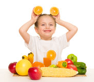 Little girl with fruits and vegetables Stock Images
