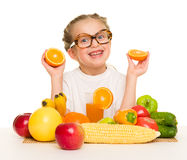 Little girl with fruits and vegetables Royalty Free Stock Image