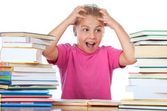little girl frustated between many books  Stock Photography
