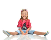 Little girl full body sitting in sunglasses yelling screaming Royalty Free Stock Photo