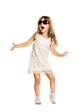 Little girl fun dancing in the glasses. Isolated on white background Stock Image