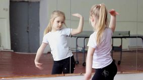 Little girl fun dancing training exercise in front of mirror stock video footage
