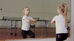 Little girl fun dancing training exercise in front of mirror stock video