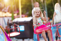 Little girl at fun fair Royalty Free Stock Photo
