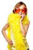 Little girl with fun orange carnaval glasses Stock Photos