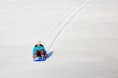 A Little Girl Fun Sled Ride Stock Images