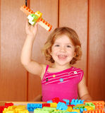 Little girl fun with toy block Stock Photos