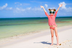 Little girl in funny Christmas glasses. Adorable little girl in a funny Christmas glasses at tropical beach royalty free stock photo