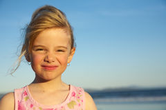 Little girl with funny expression. At the beach Royalty Free Stock Photos