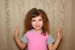 Little girl funny expression on vintage wallpaper Royalty Free Stock Photo