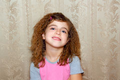 Little girl funny expression on vintage wallpaper Royalty Free Stock Photos