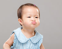 Little girl with funny face Royalty Free Stock Photo