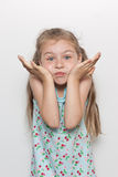 Little girl with a funny face Stock Photo