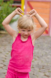 Little girl with funny gestures Royalty Free Stock Images
