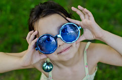 Little girl in funny glasses Royalty Free Stock Photography