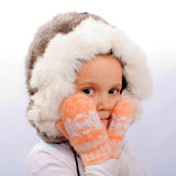 The little girl in a fur cap Royalty Free Stock Photography