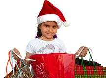 Little girl in fur-cap with shopping bags. Christmas. Little girl in fur-cap with shopping bags. Isolated over white background. Christmas Stock Photos