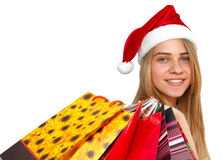 Little girl in fur-cap with shopping bags. Christmas. Little girl in fur-cap with shopping bags. Isolated over white background. Christmas Royalty Free Stock Image