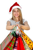 Little girl in fur-cap with shopping bags. Christmas. Little girl in fur-cap with shopping bags. Isolated over white background. Christmas Royalty Free Stock Photo