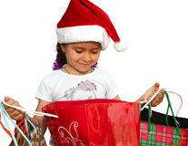 Little girl in fur-cap with shopping bags. Christmas. Little girl in fur-cap with shopping bags. Isolated over white background. Christmas Stock Photography