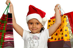 Little girl in fur-cap with shopping bags. Christmas. Little girl in fur-cap with shopping bags. Isolated over white background. Christmas Stock Image