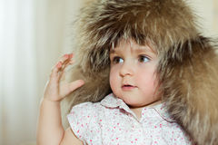 Little girl in fur hat portrait Royalty Free Stock Images