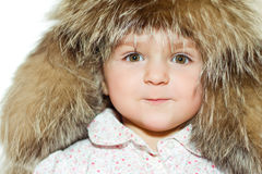 Little girl in fur hat portrait Royalty Free Stock Photos
